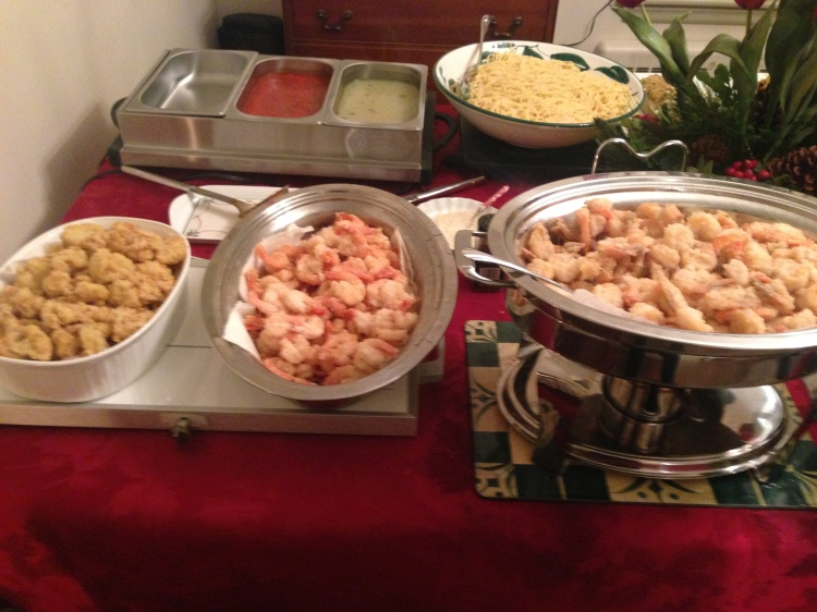In the foreground, fried shrimp and fried cauliflower. In the background, pasta with clam sauce (and a tomato sauce alternative for the various picky eaters the family has absorbed along the way.