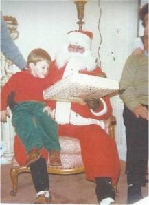 My son Rob gets a present from Santa in 1983