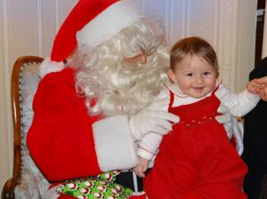 Viola and Santa in 2013, with a reassuring hand from her dad.