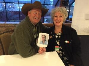 Next Dru Ann spots guest of honor Craig Johnson talking with Julie Hennrikus.