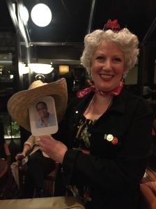 Julie Hennrikus makes sure Dru has a cowboy hat for the banquet.