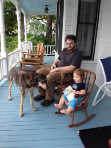 Even at one, my granddaughter understood the joy of reading on the porch.