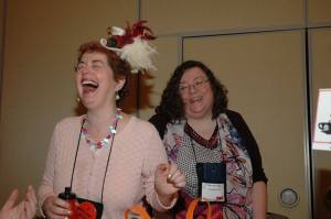 Alice Loweecey and Barbara Early having fun at Malice Go Round.