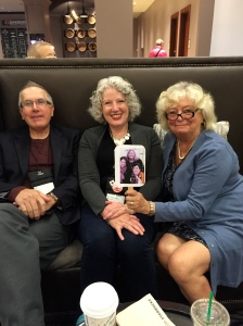 Ray Daniel, Julie Hennrikus, and Michele Dorsey holding a photo of the Wickeds who couldn't make it to Bouchercon.