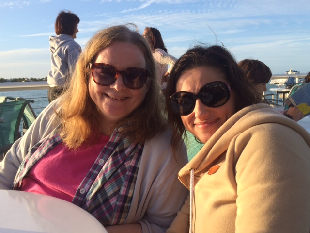 Barb and Liz drinking a margarita and mojito (respectively) on Mallory Pier at sunset, Key West