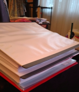 Top binder, A CHRISTMAS PERIL, ready for copy edits final round. Bottom binder, WITH A KISS I DIE, ready for first read before I send it out.