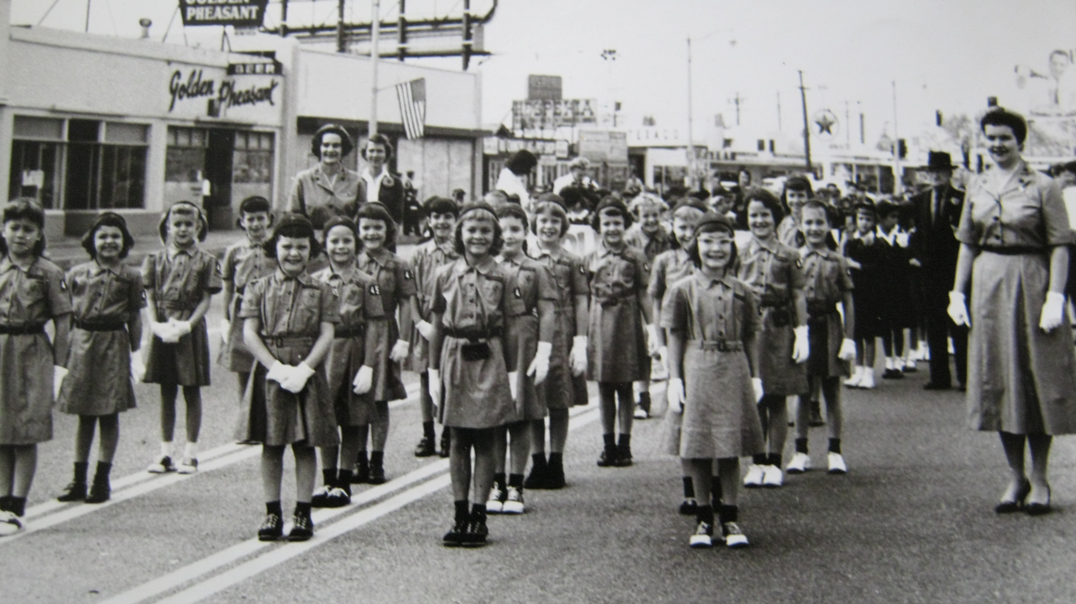 Debbie and Edith as Brownies marching in the parade, circa 1961.